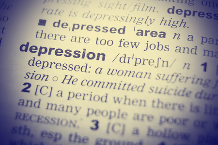 English dictionary: Close-up of word in English dictionary. Depression, definition and transcription.