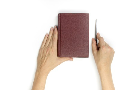 hardcover: Hands hold blank red hardcover book on white background.