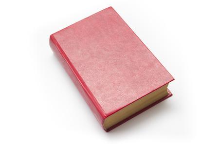 Libro dalla copertina rigida rosso in bianco su fondo bianco con lo spazio della copia.