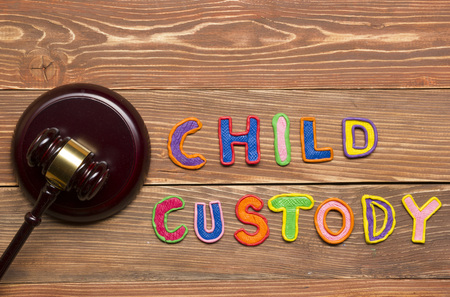 Judge gavel and colourful letters regarding child custody, family law concept Stock Photo