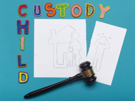 in custody: Judge gavel and colourful letters regarding child custody, family law concept Stock Photo