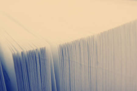 book concept: Macro view of book pages. Toned image Stock Photo