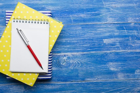 Top View of Creative Writing Concept With Pencils, Book, Notepad on Wooden Table. Copy space for text. Stock Photo