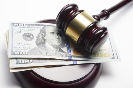 bill of rights: judge gavel on american dollars on white background.