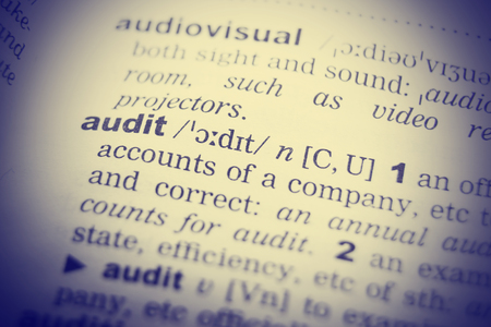 A close up of the word audit from a dictionary Stock Photo