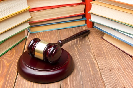 criminal case: Law concept - Law book with a wooden judges gavel on table in a courtroom or law enforcement office Stock Photo