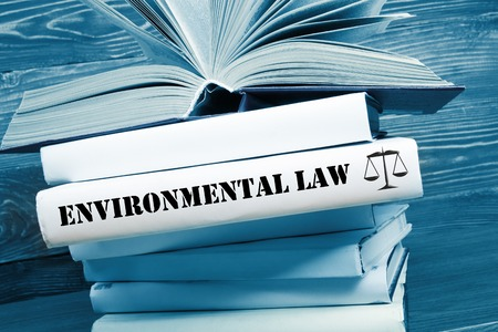 Law concept - Law book with Environmental Law word on table in a courtroom or law enforcement office. Toned image.