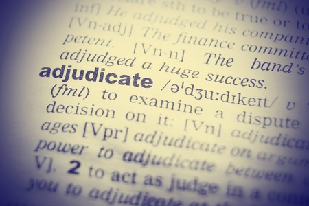 adjudicate: Dictionary definition of adjudicate. Close up view with paper textures.