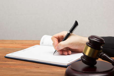 business letters: Lawyew working. Notary public signing document at his workplace