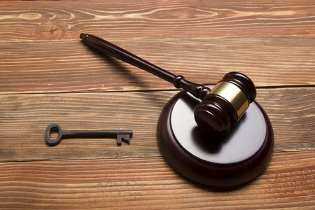 inherit: Judges Or Auctioneer Gavel, Retro Door Key On The Wood Table. Concept For Trial, Bankruptcy, Tax, Mortgage,  Auction Bidding, Foreclosure Or Inherit Real Estate. Stock Photo