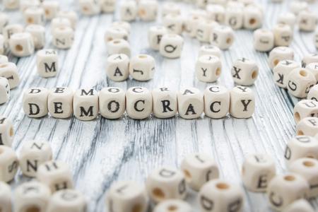 d�livrance: Democracy word written wood block. Wooden ABC.