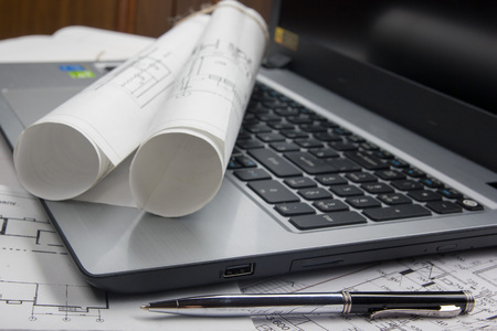 blueprint: Workplace of architect - Architectural project, blueprints, rolls and tablet, pen, divider compass on plans. Engineering tools view from the top. Construction background. Copy space for text