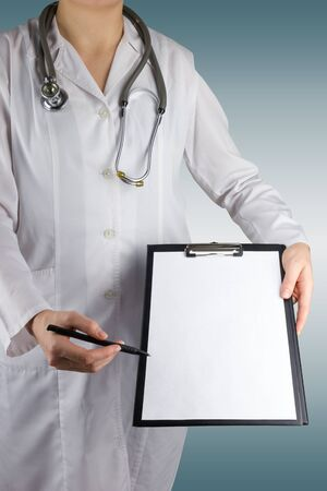 Female doctors hand holding stethoscope and clipboard on blue blurred background. Concept of Healthcare And Medicine. Copy space. Stock Photo