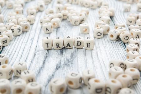 TRADE word background on wood blocks. Wooden ABC. Stock Photo