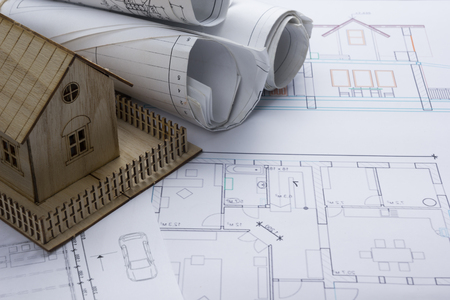 architect tools: Real Estate concept. Architectural project, blueprints, blueprint rolls and  divider compass on vintage wooden table. Top view. Construction background. Engineering tools. Architect workplace