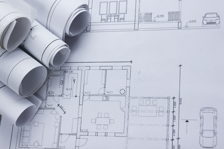 architect tools: Architect worplace top view. Architectural project, blueprints, blueprint rolls on plans. Construction background. Engineering tools. Copy space. Stock Photo