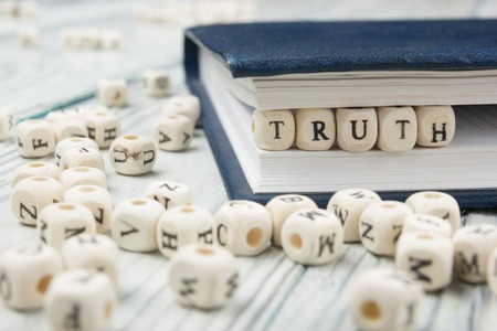 truth word background on wood blocks. Wooden Abc. 스톡 콘텐츠