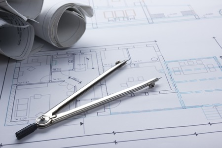 architect tools: Architect worplace top view. Architectural project, blueprints, blueprint rolls and  divider compass on plans. Construction background. Engineering tools. Copy space.