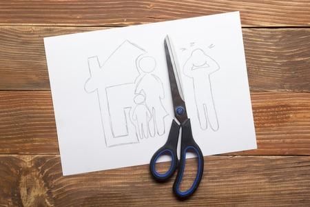 scissors cutting paper: Family law concept. Divorce section of the property by legal means. Scissors cutting paper.