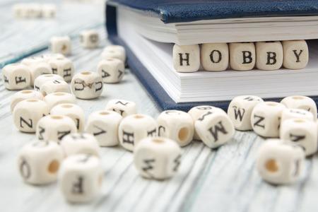 HOBBY word written on wood block. Wooden ABC.
