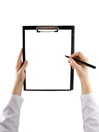 female hand holding a pen and clipboard with blank paper or document, report isolated on white background. Top view.