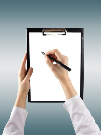 taking inventory: female hand holding a pen and clipboard with blank paper or document, report on blue blurred background. Top view.