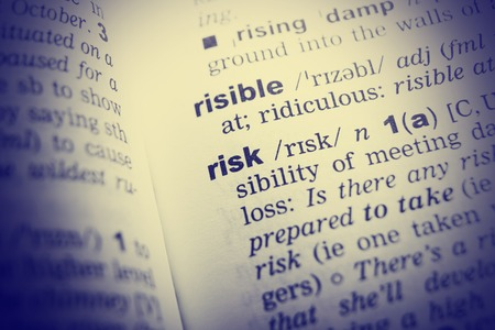 English dictionary: Close up of English dictionary page with word risk. Stock Photo