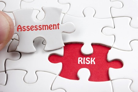 Risk Assessment. Missing jigsaw puzzle pieces with text Stok Fotoğraf - 54044336