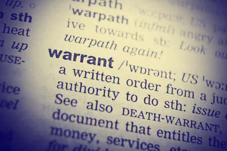 Dictionary definition of the word Warrant . Toned Image.