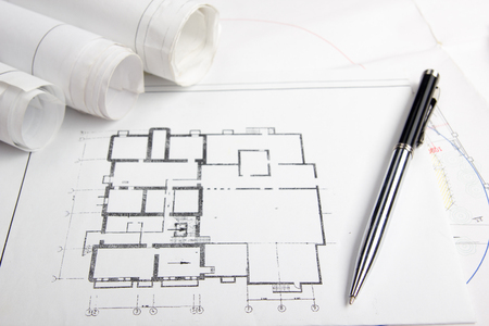 house blueprint: Workplace of architect - Architectural project, blueprints, rolls and tablet, pen, divider compass on plans. Engineering tools view from the top. Construction background. Copy space for text