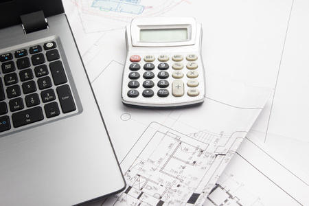 architect tools: Workplace of architect - Architectural project, blueprints, rolls and tablet, pen, divider compass on plans. Engineering tools view from the top. Construction background. Copy space for text