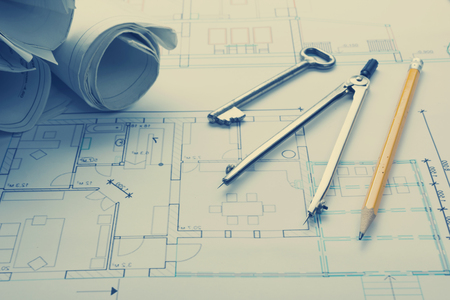 architect tools: Architect worplace top view. Architectural project, blueprints, blueprint rolls and  divider compass, pencil on plans. Construction background. Engineering tools. Copy space.