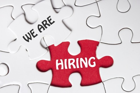 missing piece: HIRING concept.  Missing Piece Jigsaw Puzzle with word.