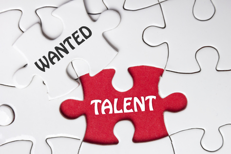 missing piece: HIRING concept. Missing Piece Jigsaw Puzzle with word Talent Wanted.