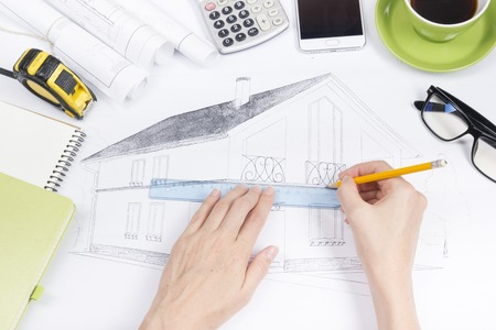 architect tools: Architect working on blueprint. Architects workplace - architectural project, blueprints, ruler, calculator, laptop and divider compass. Construction concept. Engineering tools. Top view