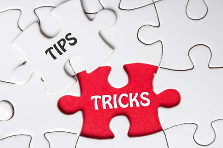 missing piece: Tips and Tricks. Missing Piece Jigsaw Puzzle with word. Stock Photo