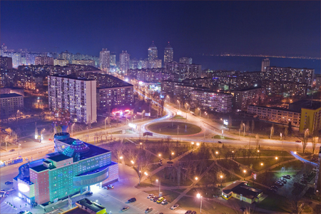 Highway at night in modern city. Aerial view of cityscape. Stock Photo