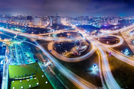 Highway at night in modern city. Aerial view of cityscape. Reklamní fotografie