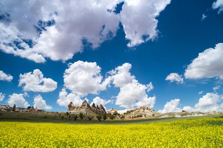 Love valley in Goreme village, Turkey. Rural Cappadocia landscape. Stone houses in Goreme, Cappadocia. Countryside lifestyle