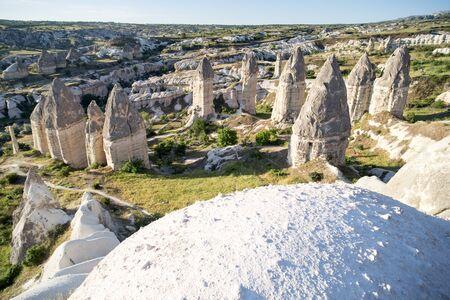 Love valley in Goreme village, Turkey. Rural Cappadocia landscape. Stone houses in Goreme, Cappadocia. Countryside lifestyle. Stock Photo