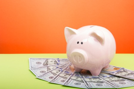 Piggy bank and dollar cash money. Business, finance, investment, saving and corruption concept Stock Photo