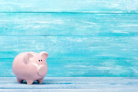 Piggy bank for saving money concept on a blue background. Copy space for text 版權商用圖片