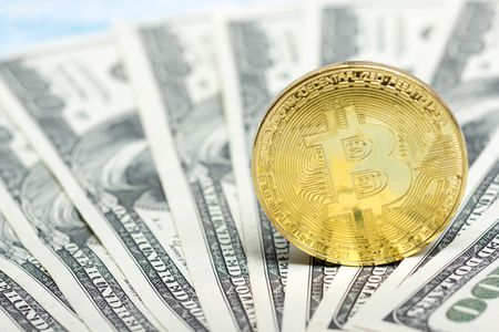 Bitcoin golden coin New virtual money and dollar background . Cryptocurrency. Business and Trading concept. Close-up shot Stock Photo