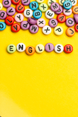 English word composed from colorful abc alphabet block wooden letters, copy space for ad text. Education concept. Standard-Bild