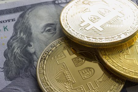 Bitcoin golden coin New virtual money and dollar background . Cryptocurrency. Business and Trading concept. Close-up shot Archivio Fotografico