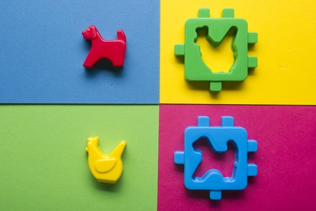 Kids educational developing toys frame on colorful background. Top view. Flat lay. Copy space for text. Stock Photo
