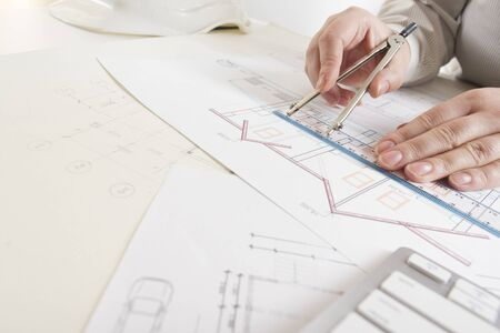 architects working on blueprint real estate project architect