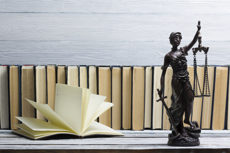 Legal Law concept - Open law book with a wooden judges gavel on table in a courtroom or law enforcement office. Copy space for text 写真素材 - 97961862