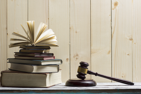 Legal Law concept - Open law book with a wooden judges gavel on table in a courtroom or law enforcement office. Copy space for text 写真素材 - 97961870