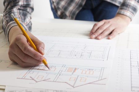 Architects working on blueprint, real estate project. 写真素材 - 97961912